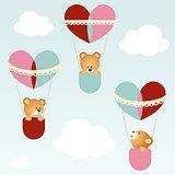 Teddy bears flying in heart hot balloons