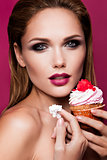 Beautiful fashion girl with cupcake