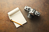 old analogue camera and notepad