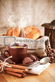 Cup hot coffee with beans and chocolate candies