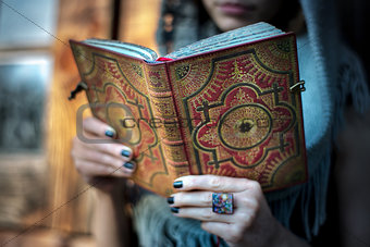Casual woman with a book on her hands