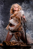 Woman In Fur With Sword