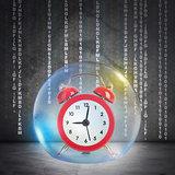 Red alarm clock in bubble
