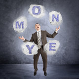 Businessman juggling word money