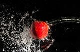 Water splash and apple