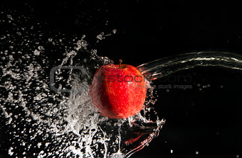 Water splash and apple