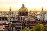 View of Basilica of Guadalupe with Mexico city skyline at sunset