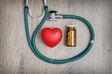 Stethoscope, pills and a heart
