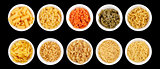 Set of different types of pasta on the black background
