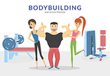 Happy bodybuilder with two women in the gym