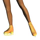 Female legs in gold ice skates
