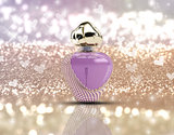 3D perfume bottle on glitter background