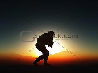 3D soldier against sunset sky