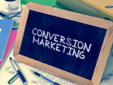 Conversion Marketing Handwritten by White Chalk on a Blackboard.