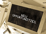 New Opportunities - Chalkboard with Hand Drawn Text.