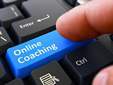 Online Coaching - Concept on Blue Keyboard Button.