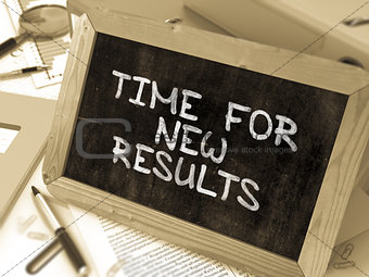 Time for New Results Handwritten by White Chalk on a Blackboard.