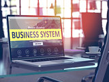 Business System on Laptop in Modern Workplace Background.