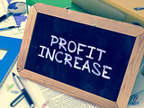 Hand Drawn Profit Increase Concept on Small Chalkboard.