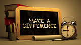 Make a Difference - Chalkboard with Hand Drawn Text.