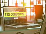 Laptop Screen with SEO Consulting Concept.