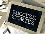 Handwritten Success Stories on a Chalkboard.