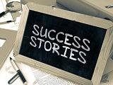 Handwritten Success Stories on a Chalkboard.