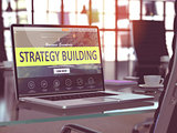 Strategy Building on Laptop in Modern Workplace Background.
