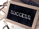 Success Handwritten by White Chalk on a Blackboard.