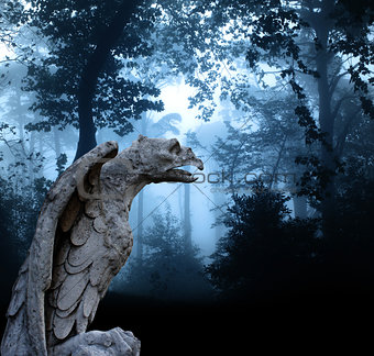Ancient eagle statue in misty forest