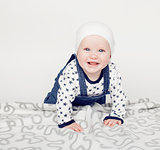 little cute baby toddler on carpet isolated close up smiling