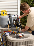 Repairman Checking Levels On Air Conditioner