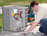 Repairman Working On Air Conditioner Unit