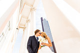 bride and groom on the background of glass building