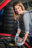Lovely female car mechanic in auto repair service