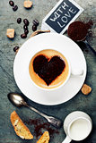 Cup of coffee with heart on foam