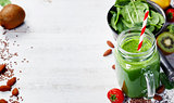Healthy green smoothie and ingredients