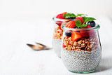 Chia seeds vanilla pudding and berries on wooden rustic backgr