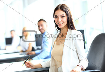 business woman with her staff, people group in background