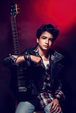 Handsome teen guitarist