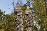 Two heads of wooden idols in the wood