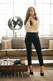 Stylish elegant woman in loft room holding smartphone