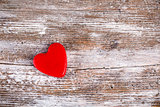 Red heart on grunge wood background