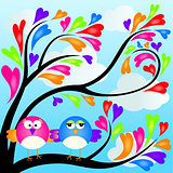 Couple birds on heart tree