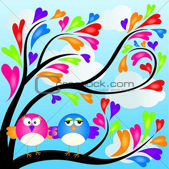 Couple birds on heart tree
