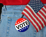 vote button and flag in pocket