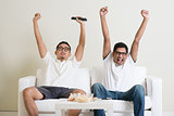Men watching football match on tv together