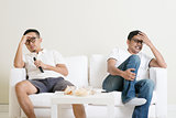 Men watching football match together