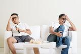 Men watching football match together