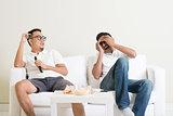 Men watching movie together